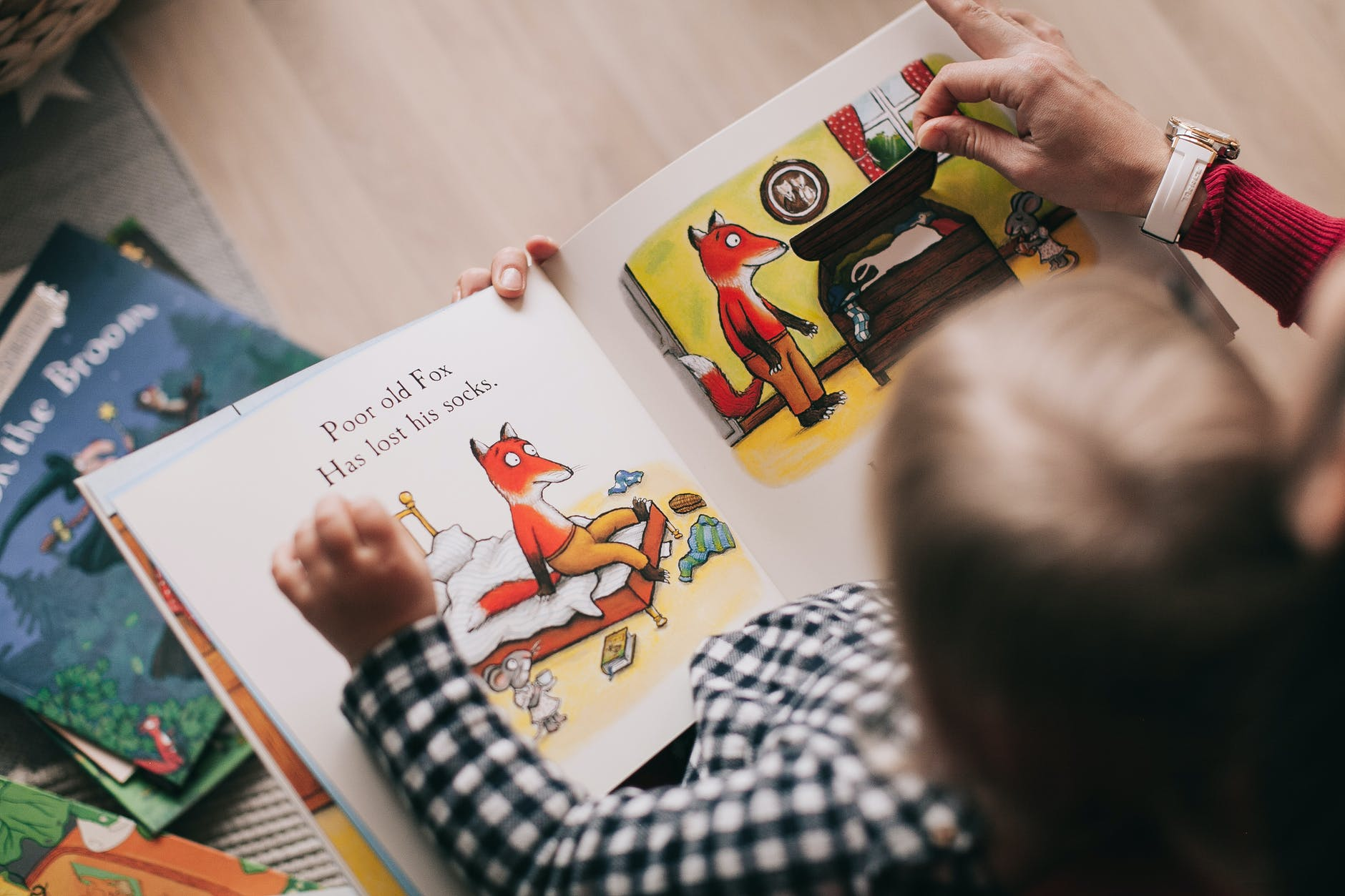 person teaching a child to read
