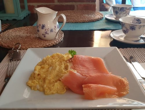 Square plate of smoked salmon and scrambled egg
