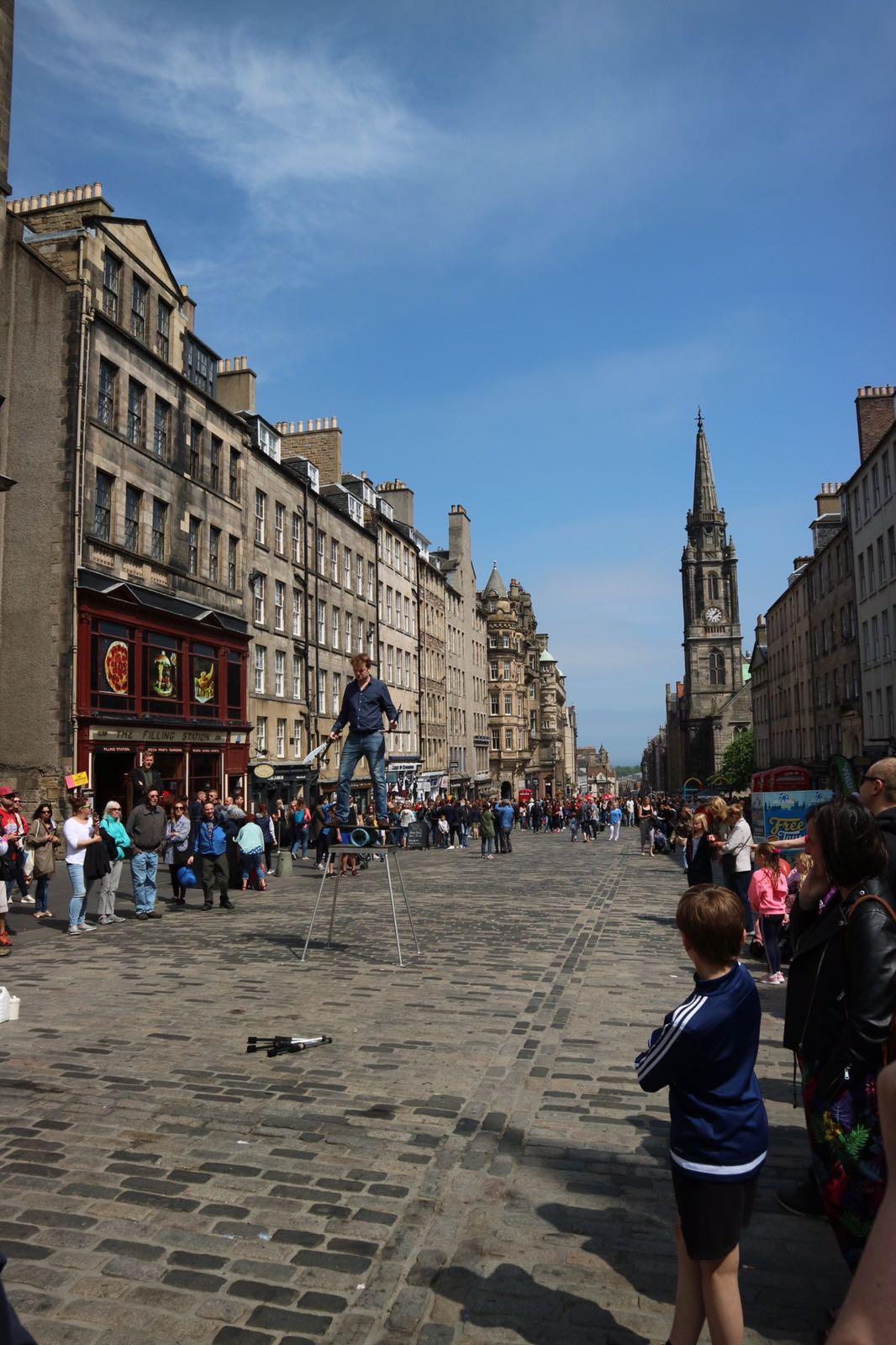 Street performer on stilts on Edinburgh Royal Mile