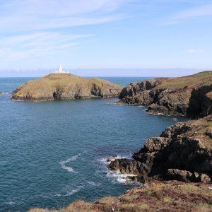 White lighthouse on an island off the coast
