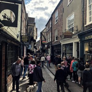Medieval shopping street full of people