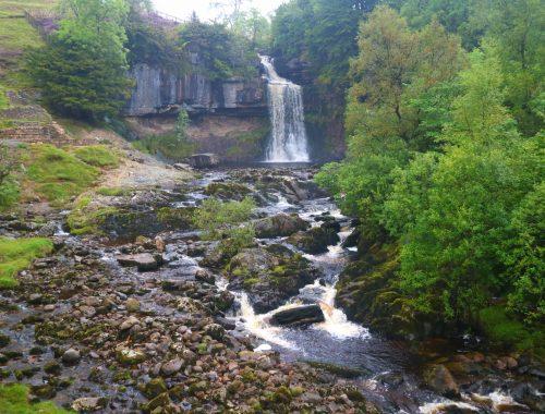 Large, single drop waterfall at Ingleton Waterfall Trail