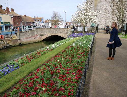Woman standing beside Canterbury canal