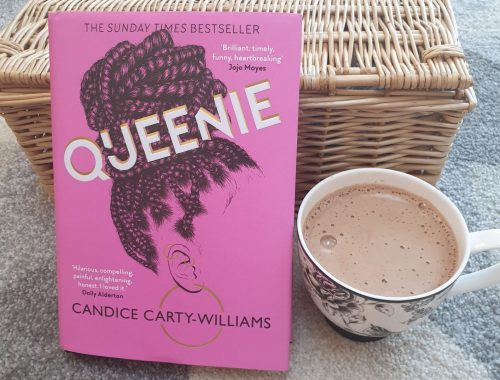 Cover of hardback Queenie by Candice Carty-Williams, by picnic hamper and hot chocolate